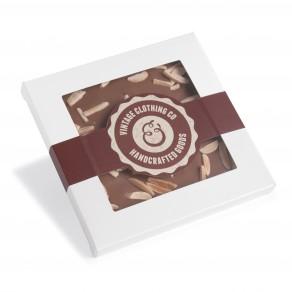 Handgeschöpfte Schokolade in quadratischer Kartonage mit Sichtfenster